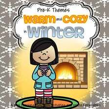 girl holding cocoa by fireplace in winter